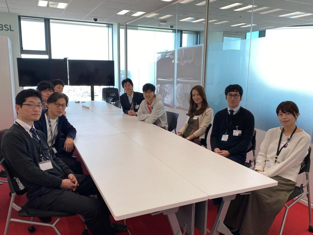 Genta Nishimura with teammates in Rakuten's Tokyo headquarters.