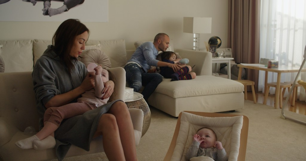 Iniesta at home with his wife and children