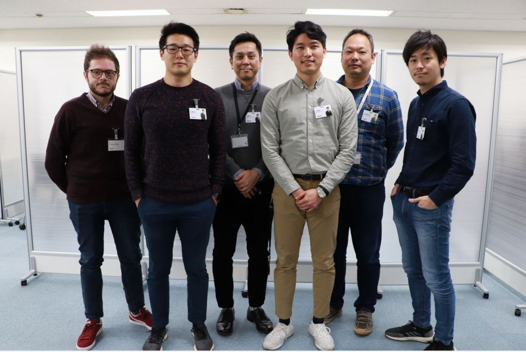 Paul (third from right) with Rakuten Mobile teammates in Tokyo.
