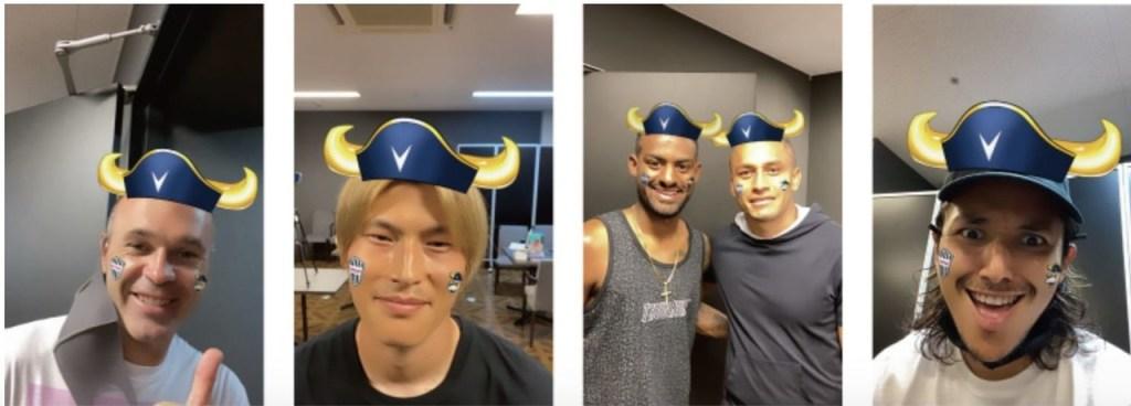 Andres Iniesta, Kyogo Furuhashi, Dankler, Douglas and Leo Osaki try on the horns of bovine team mascot MOVI.