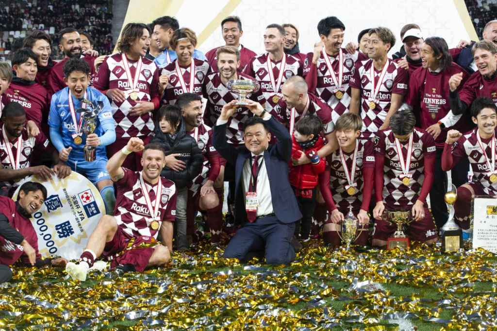 Mickey Mikitani, Vissel Kobe players and family celebrate the team's historic Emperor's Cup victory on January 1, 2020 — marking the first title in team history.