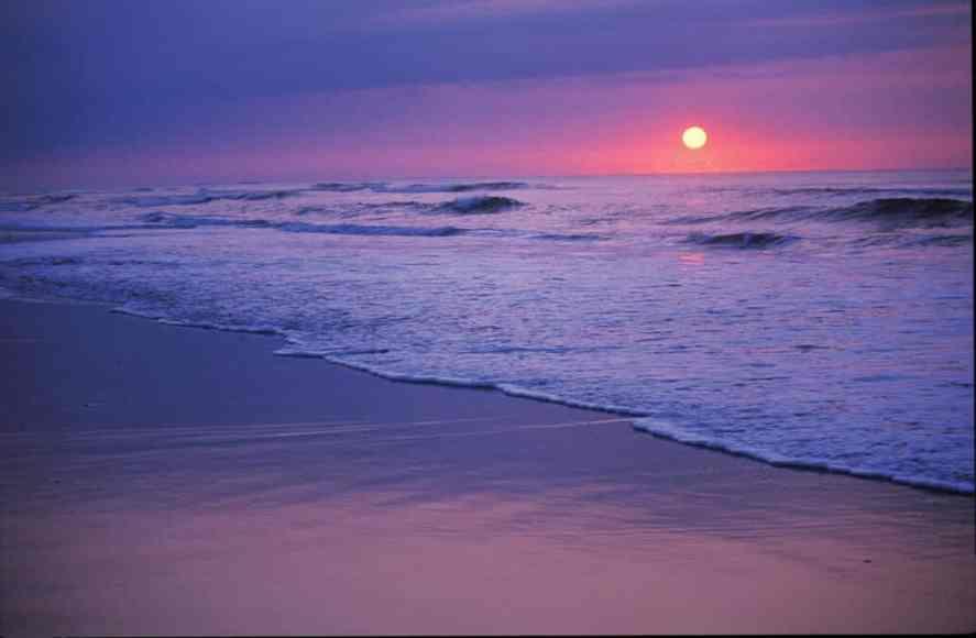 The sun rises over the Atlantic Ocean on the North Carolina coast.