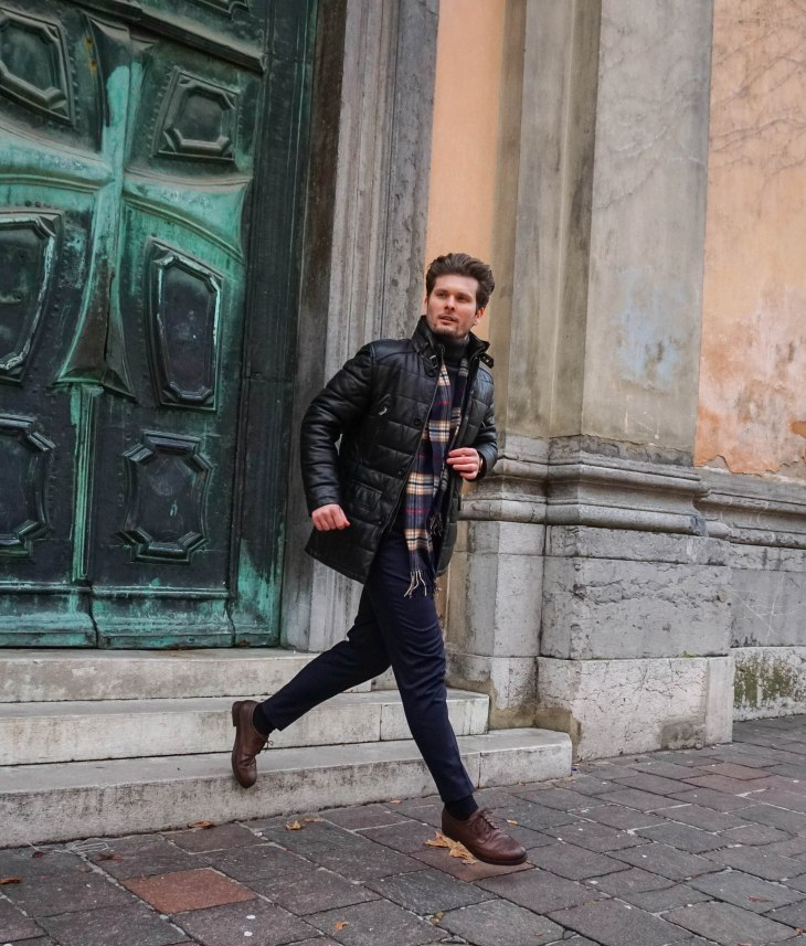 Rale Popic, Armani turtleneck, Picard briefcase, Leather jacket, Henry London watch