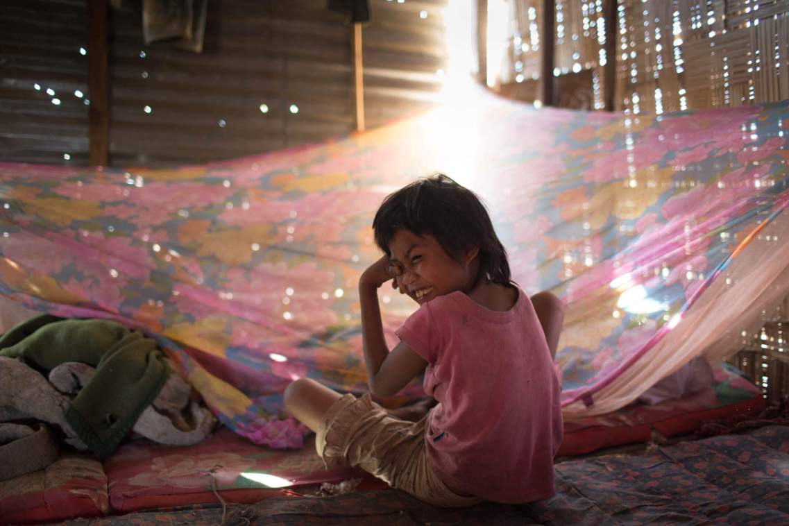 Girl with mosquito net, Laos.