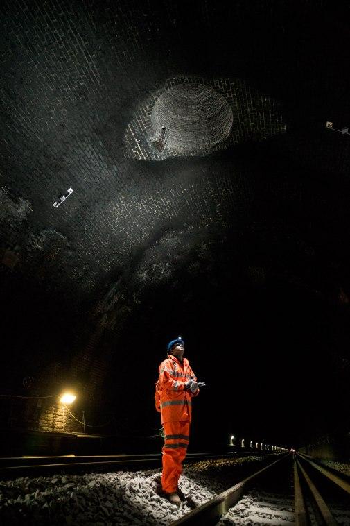 Surveyor at work inside Brunel's famous Box Tunnel, Avon.