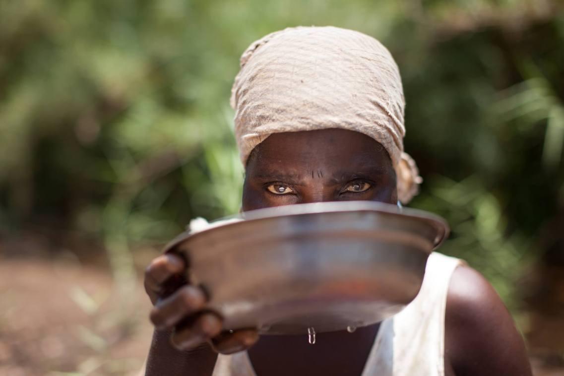 Woman at well, Salima, Malawi.
