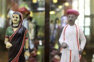 Rows of clay figurines display the rich ethnic variety of Mumbai, both indigenous and immigrant, through their traditional attires.