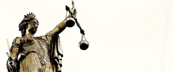 Themis, blindfolded, holding the scales of justice