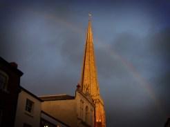 Photo of rainbow behind church