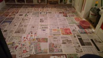 Making the newspaper template with which to cut the vinyl
