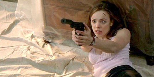 Rachel aiming a gun at someone who won't give her anal.