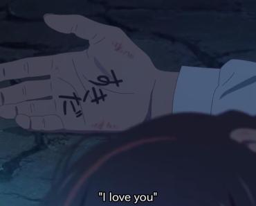 What did taki write on mitsuha's hand