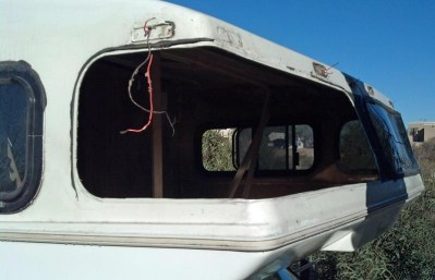 removed warped, leaky front cabover windows.