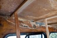 large area of damaged fiberglass in need of repair.