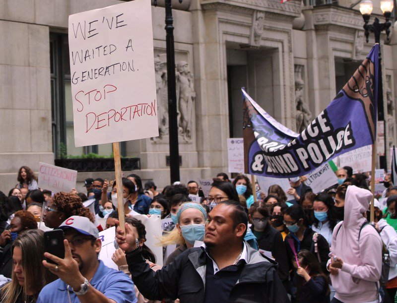 """One sign above a large march reads """"We've Waited a Generation, Stop Deportations"""""""