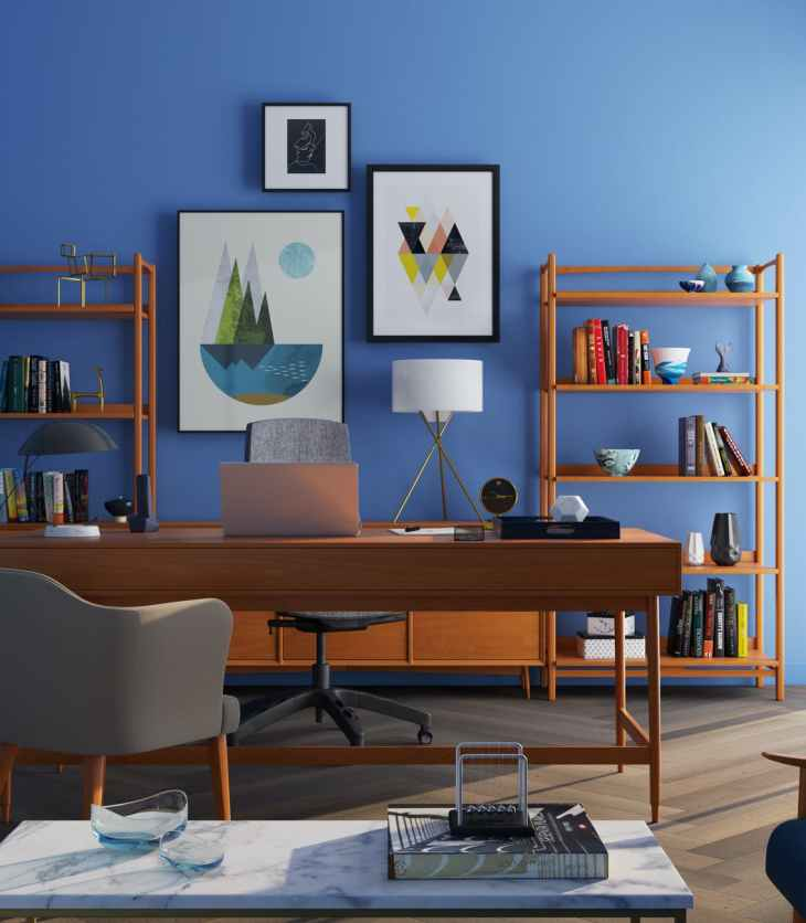 brown wooden desk with rolling chair and shelves near window