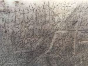 Is this Persian grafitti or just scratches on the wall of the minar just below the arches?