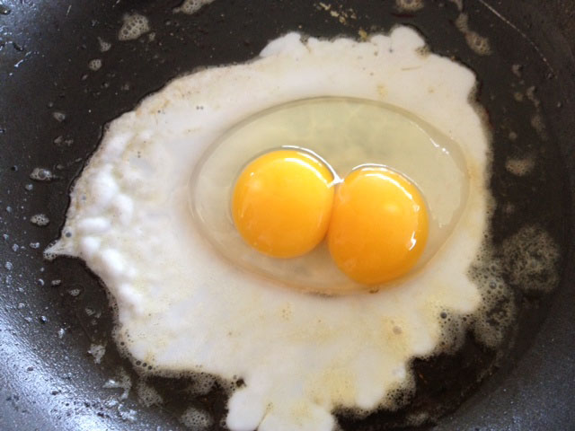 Double egg with double-yolk, fried up for breakfast.