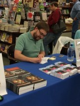Novelist Randal Eldon Greene signing his book Descriptions of Heaven at Barnes & Noble in Sioux City, Iowa.