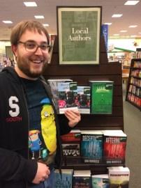 Local Sioux City author Randal Eldon Greene with a copy of his novel Descriptions of Heaven.