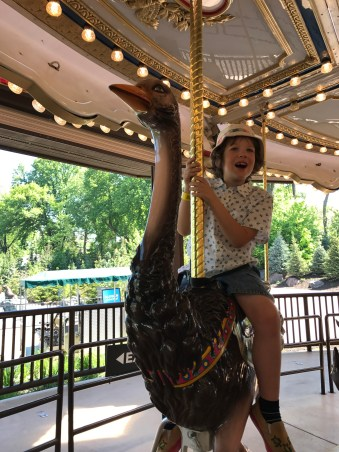 Riding the carousel at Henry Doorly Zoo