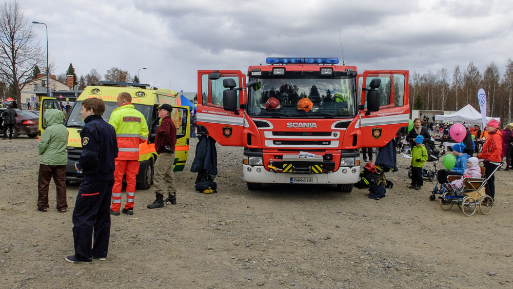 Fire truck, ambulance and spectators