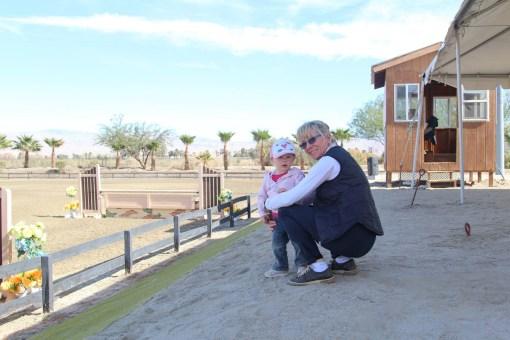 Grandma and Ry watching the horses jump