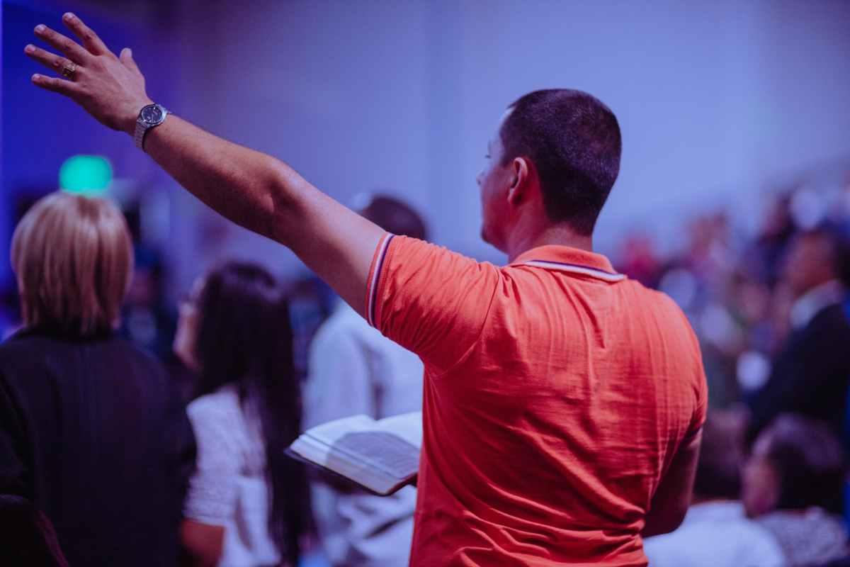man raising his left hand @randomnestfamily.org