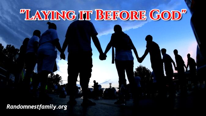 People praying in a circle @randomnestfamily.org