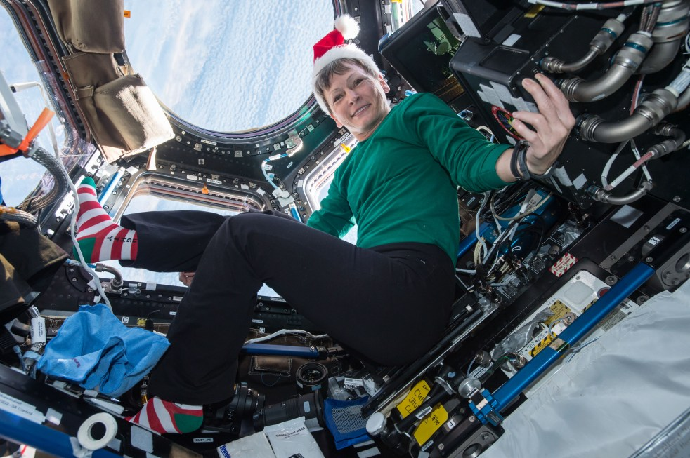 Aboard ISS Expedition 50 NASA engineer Whitson of NASA sent holiday greetings and festive imagery from the cupola on Dec. 18, 2016