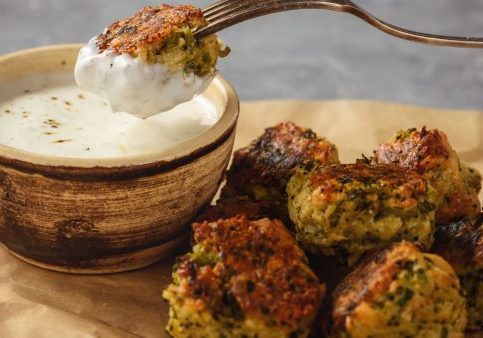 Baked broccoli cheese balls with garlic dip, vegetarian food.
