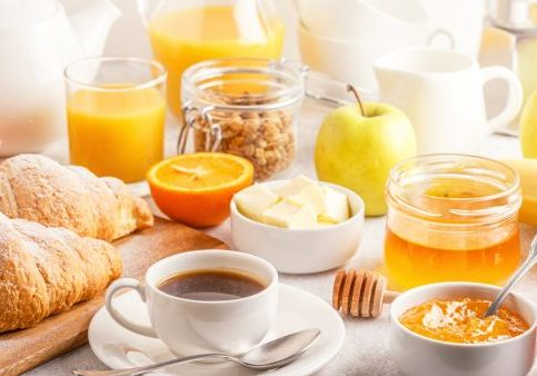 Continental breakfast with fresh croissants, orange juice and coffee, selective focuse.