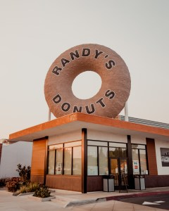 Exterior of Randy's Inglewood location with giant rooftop donut
