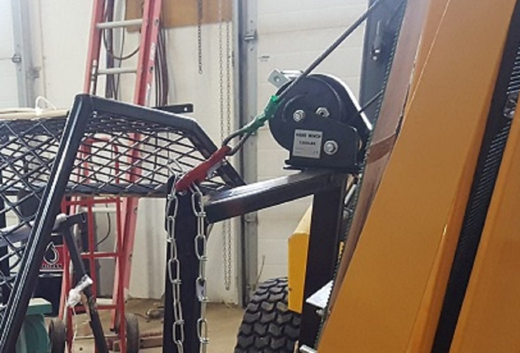 Conveyor winch bracket