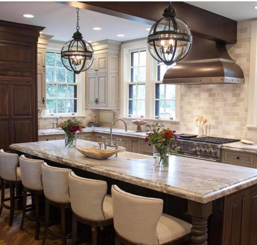 luxury kitchen with a range hood