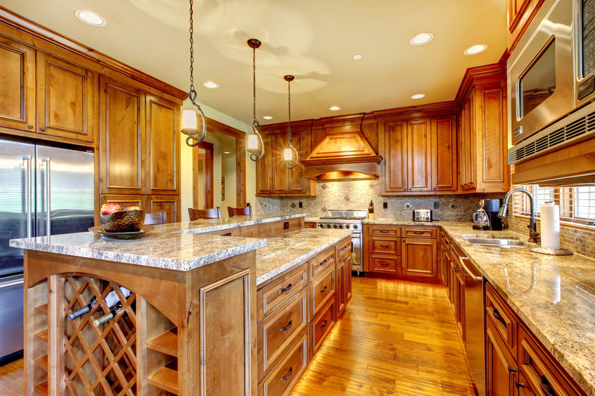 Brilliant kitchen with stained wood cabinets and hardwood floor.