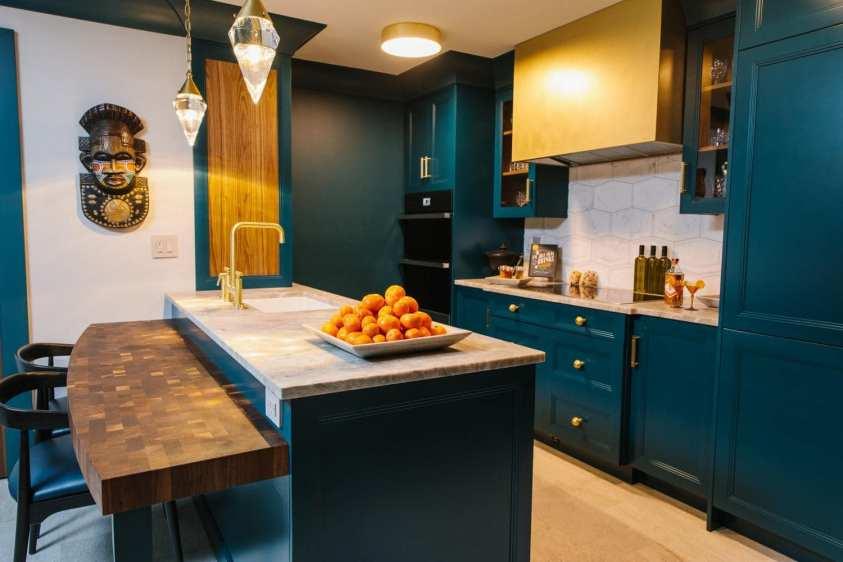 beautiful kitchen with a custom brass hood