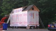 Sheathing completed. House wrap and tar paper done. Basically water tight.