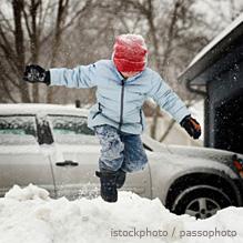 boy leaping snow