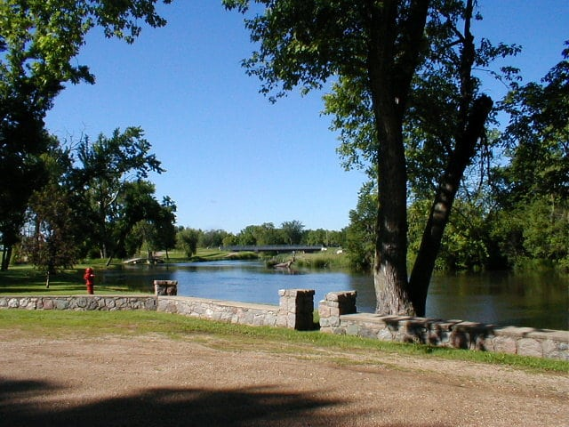 lake surrounded by a retaining wall and trees