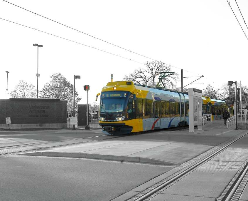 Lightrail at stop on summer day