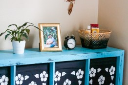 Painted an old coffee brown Ikea dresser to turquoise blue and distressed it. But no one seems to 'get' this whole distressed look though, they think it's the result of a bad paint job. Ugh.