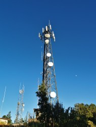 Cell Phone tower with microwave relay dishes.