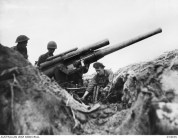 1943-01-08. ALLIED ADVANCE ON BUNA. ALLIED TROOPS EXAMINING ONE OF TWO JAPANESE 3-INCH NAVAL GUNS USED BY THE ENEMY IN THEIR DEFENCE OF BUNA. THIS GUN WAS CAPTURED BY AUSTRALIANS ON THE STRIP AT BUNA. IT WAS PROBABLY USED ALSO AS AN ANTI-AIRCRAFT GUN AND WAS MANNED BY MARINES.