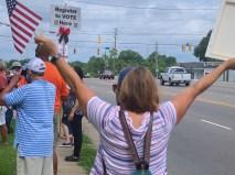 Bernadette Russell holds an American flag