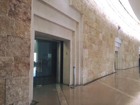 The five courtroom entrances were designed to resemble traditional Middle Eastern courthouses.