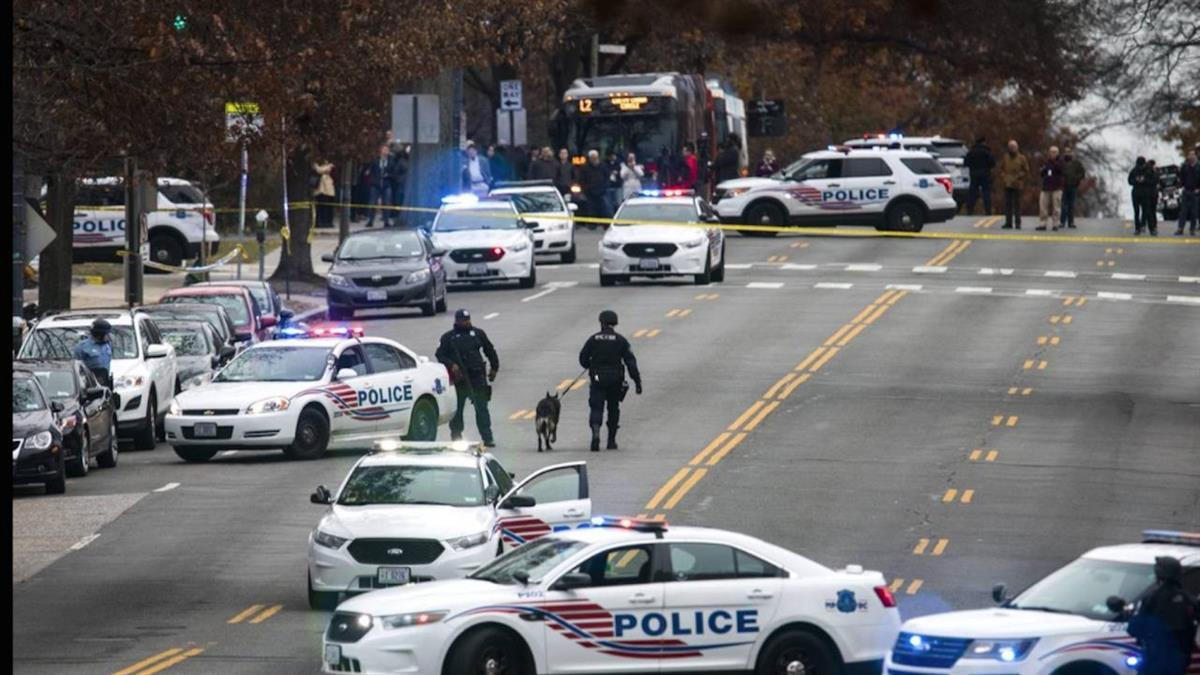 Police shut down Connecticut Avenue, one of Washington, D.C.'s main arteries, after the incident Sunday. PHOTO: JIM LO SCALZO/EUROPEAN PRESSPHOTO AGENCY