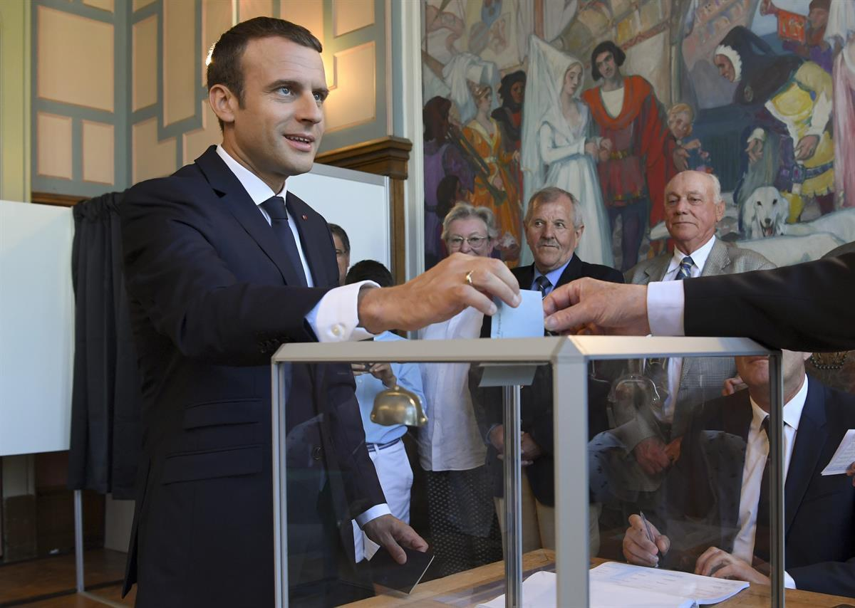 French President Emmanuel Macron casts his ballot as he votes at a polling station in Le Touquet, northern France, in the second round of the French parliamentary elections — Sunday, June 18, 2017. (Christophe Archambault/AP)
