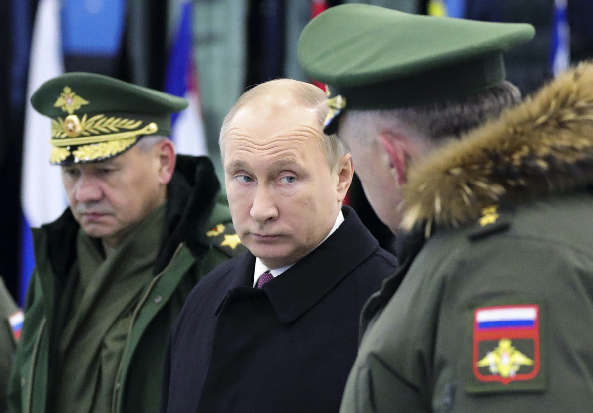 Russian President Vladimir Putin, center, speaks to Russian Strategic Missile Troops Commander, Col. Gen. Sergei Karakayev, right, as Russian Defence Minister Sergei Shoigu, left, stands next to him outside Moscow, Russia — Dec. 22, 2017(Mikhail Klimentyev, Sputnik, Kremlin Pool Photo via AP)
