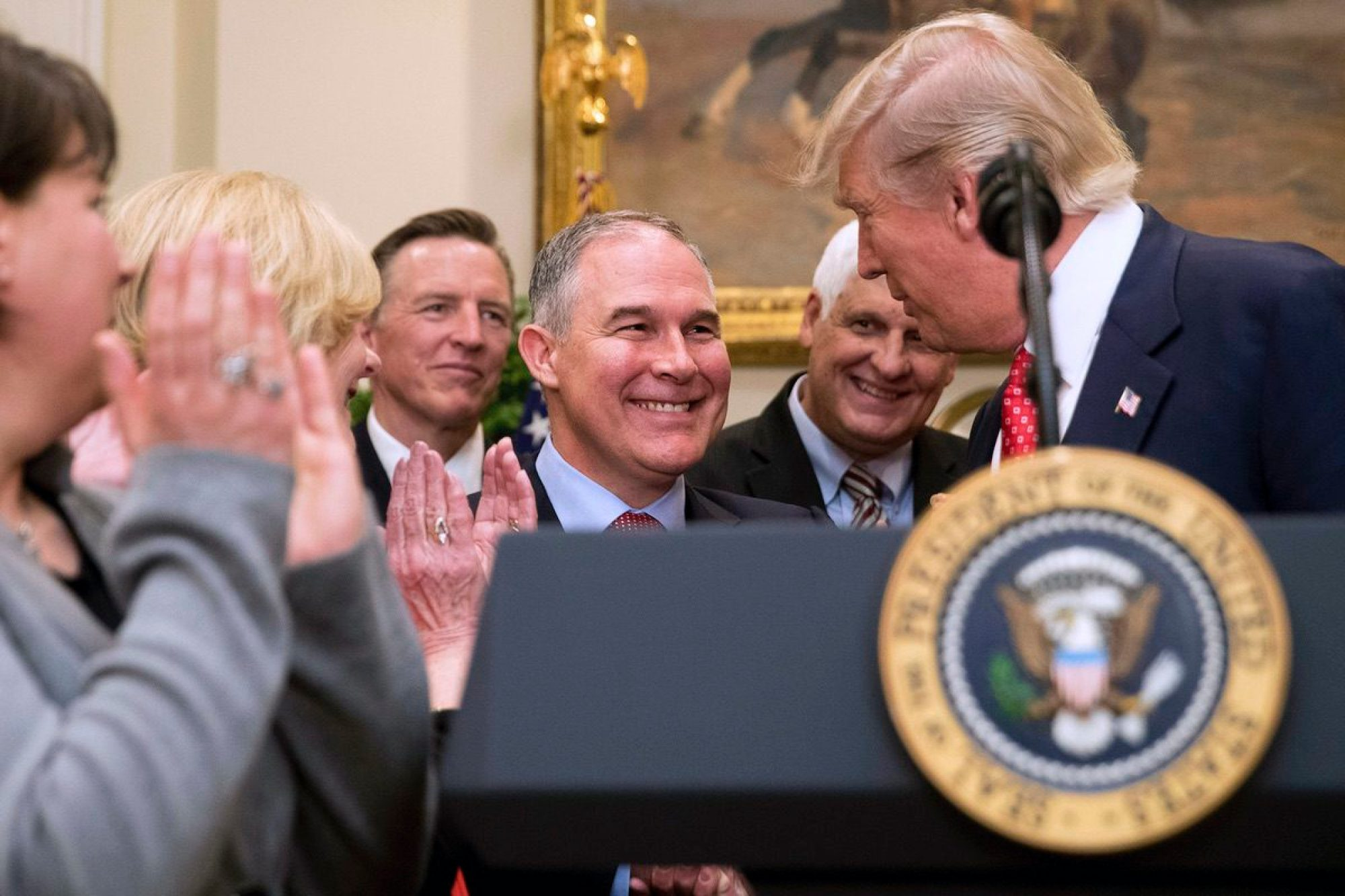 President Donald Trump, right, shakes hands with Environmental Protection Agency (EPA) Administrator Scott Pruitt, center, in the Roosevelt Room in the White House, Tuesday, Feb. 28, 2017. (AP Photo/Andrew Harnik)